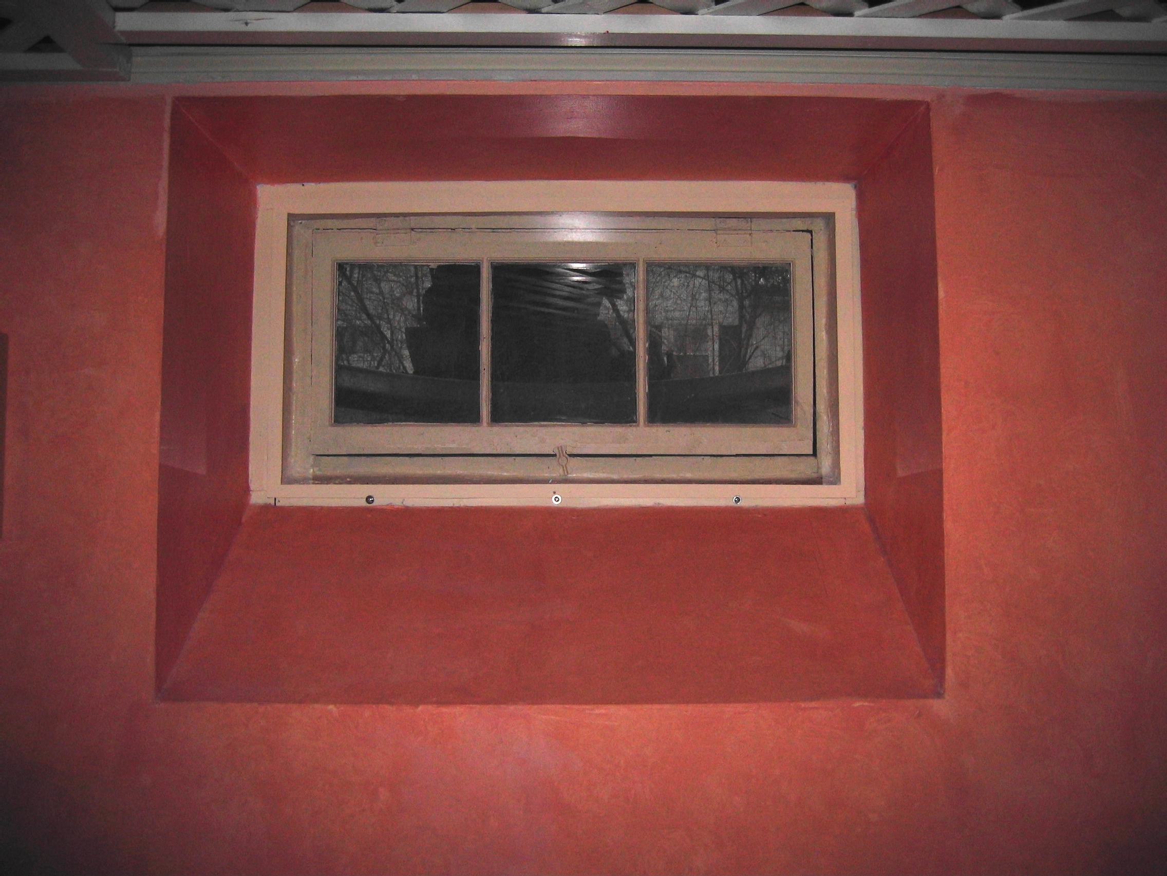 the basement window at left was custom designed with an interior